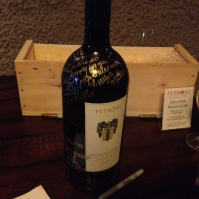 A huge bottle of wine that everyone signed for the happy couple.